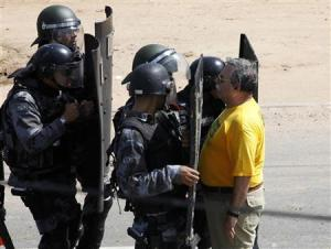 File picture shows a man facing riot police holding shields in Fortaleza