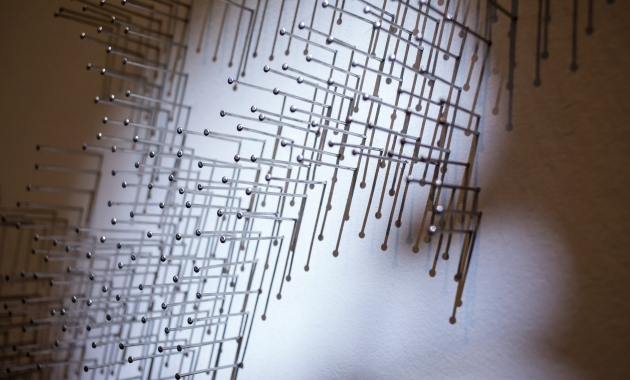 Photo of Maya Lin artwork, Pin River. Thousands of stainless steel nails nailed into the wall taking the shape of the Ohio aquifer system as it has been changed by human behavior.